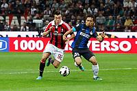 """Stephan El Shaarawy Milan Yuto Nagatomo Inter<br /> Milano 07/10/2012 Stadio """"San Siro""""<br /> Football Calcio Serie A 2012/13<br /> Milan v Inter<br /> Foto Insidefoto Paolo Nucci"""
