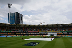 Eain stops play after lunch during day one of the Ashes Test match at The Gabba, Brisbane.