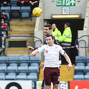 Dundee&rsquo;s Kostadin Gadzhalov outjumps Hearts&rsquo; Don Cowie - Dundee v Hearts - Ladbrokes Premiership at Dens Park <br />  - &copy; David Young - www.davidyoungphoto.co.uk - email: davidyoungphoto@gmail.com