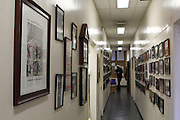 26 February 2013. Bronx, New York. Engine Co. 73/Hook & Ladder 42 at 655-659 and 661 Prospect Ave., the Bronx. Pictures line the walls of the second floor of Engine Co. 73, displaying its long history. At the far left is a framed photo dedicated to Peter Bielfeld, a Co. 73 fireman who died at the World Trade Center on 9/11. 2/26/13. Photograph by Nathan Place/CUNY Journalism Photo.