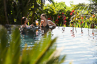 Two young women talking in natural swimming pool