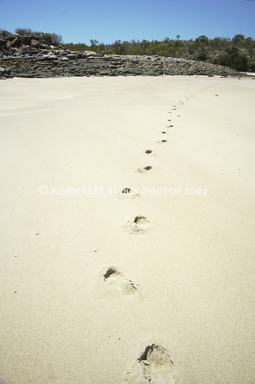 Footprints mark  a remote beach on the Kimberley coast.