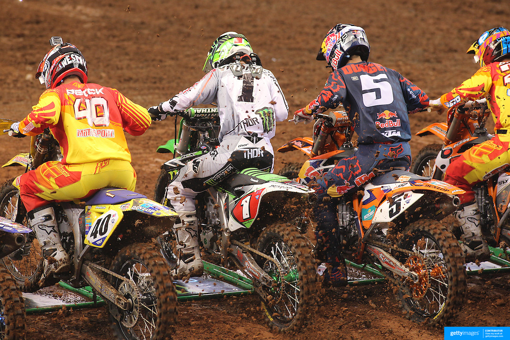 West Peick, (left), Suzuki, Ryan Villopoto, (centre, left), Monster Energy Kawasaki, Ryan Dungey, KTM, and Andrew Short, (right), KTM, jockey for position from the start during the final of the 450SX Class during the Monster Energy AMA Supercross series held at MetLife Stadium. The race, won by Ryan Villopoto clinched Villopoto his fourth consecutive 450SX Class Championship. 62,217 fans attended the event held for the first time at MetLife Stadium, New Jersey, USA. 26th April 2014. Photo Tim Clayton