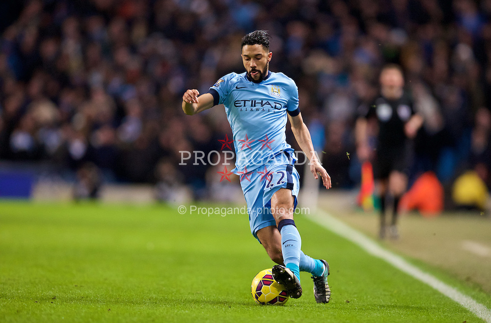 MANCHESTER, ENGLAND - Sunday, January 18, 2015: Manchester City's Gael Clichy in action against Arsenal during the Premier League match at the City of Manchester Stadium. (Pic by David Rawcliffe/Propaganda)