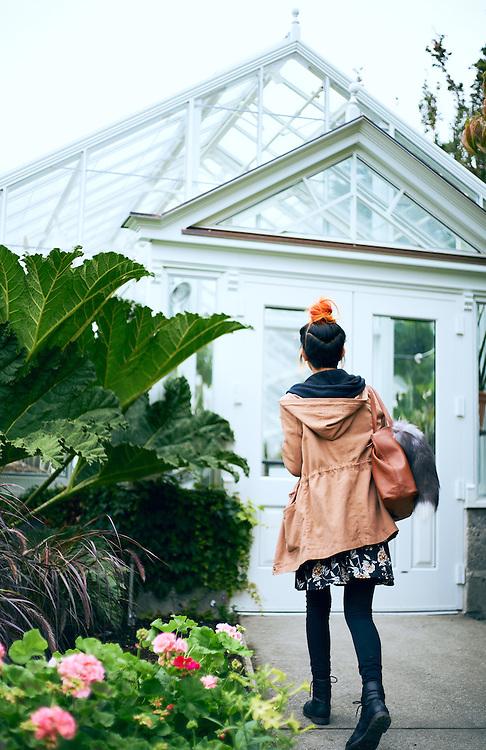 Woman Entering Volunteer Park Conservatory Seattle, Washington.