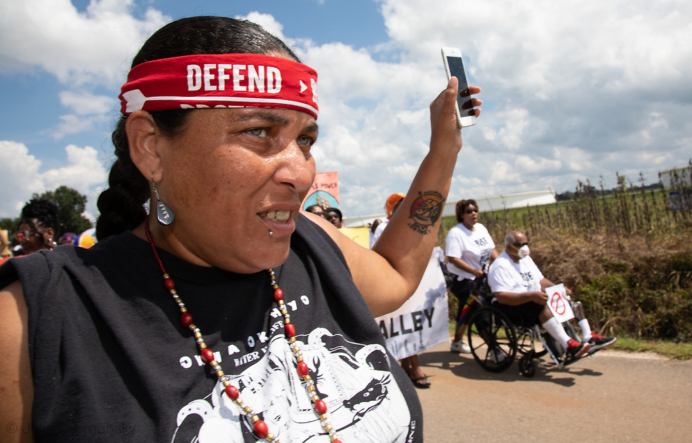 "Cherri Foytlin live streaming a march on Burton Lane in St. James, Louisiana during a ""Rise for Cancer Alley"" event, one of hundreds of 'Rise for Climate"" events world wide on Sept 8, 2018."