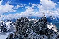 Man standing on mountain summit