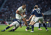 Twickenham, United Kingdom.  Billy VUNIPOLA, confronted with left Finn RUSSELL and Alex DUNBAR, before getting the ball away to Mike BROWN, during the Nations International Rugby, Calcutta Cup Game, England vs Scotland, RFU Stadium, Twickenham, England, <br />