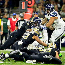 Oct 30, 2016; New Orleans, LA, USA; Seattle Seahawks running back Christine Michael (32) is tackled by New Orleans Saints outside linebacker Craig Robertson (52) and defensive end Cameron Jordan (94) during the first quarter of a game at the Mercedes-Benz Superdome. Mandatory Credit: Derick E. Hingle-USA TODAY Sports