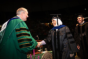 President Nellis congratulates Shrouq Hassan Aleithan on receiving her P.H.D. in physics. Photo by Ben Siegel