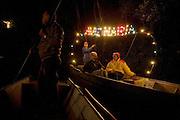 The luminous sentence Ave Maria on a boat during a night religion procession along Ticino river at Ascension Madonna Day in Motta Visconti, Milan, August 15, 2008. Procession is organized by San Giovanni Battista parish, Motta Visconti Commune and Nautical Group. ..Una barca con la scritta luminosa Ave Maria durante la processione notturna lungo il fiume Ticino per la festa della Madonna Assunta, Motta Visconti, 15 agosto 2008. La processione è organizzata dalla Parrocchia di San Giovanni Battista, dal Gruppo Nautico Mottese e dal Comune.