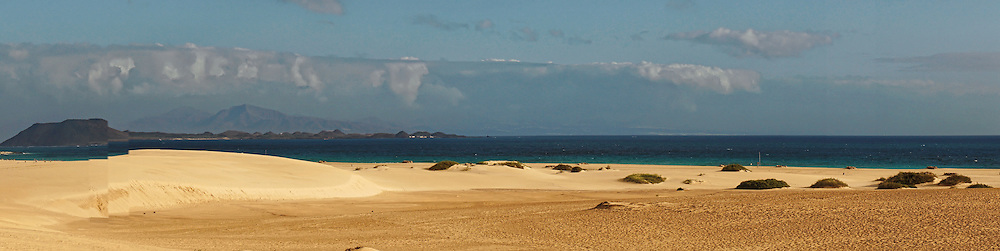 A panorama of a large sandy beach. This is at Corralejo on Fuerteventura in the Canary Islands.