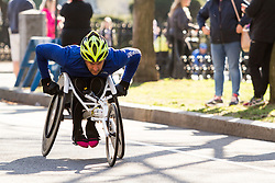 Boston Marathon: BAA 5K road race, wheelchair athlete on course