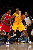 25 February 2011: Center Andrew Bynum of the Los Angeles Lakers dribbles the ball while being defended by Ike Dioju of the Los Angeles Clippers during the first half of the Lakers 108-95 victory over the Clippers at the STAPLES Center in Los Angeles, CA.