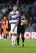Grant Hall (QPR defender) congratulating Derek Asamoah on a hard fought win during the Capital One Cup match between Queens Park Rangers and Carlisle United at the Loftus Road Stadium, London, England on 25 August 2015. Photo by Matthew Redman.