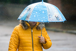 © Licensed to London News Pictures. 08/05/2019. London, UK. A woman shelters from the rain beneath an umbrella in north London during rain and wet weather morning. According to the Met Office, rain is forecasted for the next four days. Photo credit: Dinendra Haria/LNP