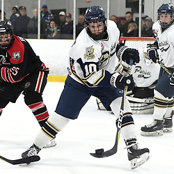 TORONTO, ON  - APR 10,  2018: Ontario Junior Hockey League, South West Conference Championship Series. Game seven of the best of seven series between Georgetown Raiders and the Toronto Patriots. Kyler Matthews #10 of the Toronto Patriots clears the puck during the second period.<br /> (Photo by Andy Corneau / OJHL Images)