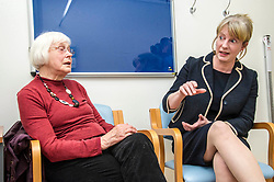 Pictured: Shona Robison met patient Margo Arnott about the services available via the district nurse system. <br /> <br /> Under pressure Health Secretary Shona Robison visited the Healthy Living Centre in Edinburgh's Wester Hailes today and annnounced details of funding for nurse training to expand community care. Ger Harley | EEm 30 April 2018