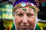 Frankfurt | 18 March 2017<br /> <br /> Am Samstag (18.02.2017) feierten &uuml;ber 30000 Kurden im Rahmen einer Demonstration das kurdische Neujahrsfest Newroz, bei der Demo sprachen sie sich gegen eine Diktatur und f&uuml;r die Freilassung von PKK-F&uuml;hrer Abdullah &Ouml;calan aus.<br /> Hier: Eine alte Frau in kurdischer Tracht hat zahlreiche Kurdistan-Souveniers und Flaggen an ihr Kopftuch gen&auml;ht.<br /> <br /> photo &copy; peter-juelich.com<br /> <br /> Nutzung honorarpflichtig!