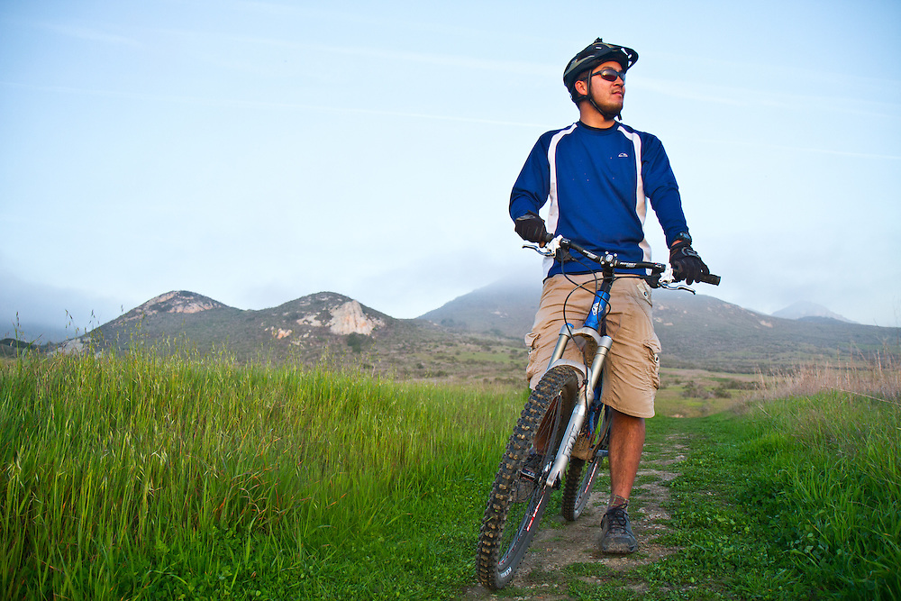 Dennis Lui takes  a moment to enjoy the ocean view while mountain biking in Morro Bay, Calif.