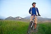Dennis Lui takes  a moment to enjoy the ocean view while mountain biking in Morro Bay, Calif.