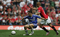 Photo: Lee Earle.<br /> Chelsea v Manchester United. The FA Cup Final. 19/05/2007.Chelsea's Joe Cole (L) pulls the shirt of Wes Brown.