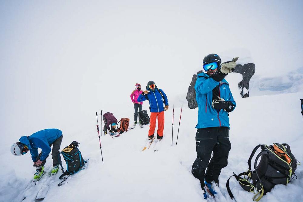 Simon says! Simon Thomson points to better snow, Howson Range, British Columbia.