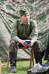 Reenactor of the NWW2A Portraying a soldier of the Großdeutschland during a battle reenactment at Fort Paull on Sunday ..5 May 2013.Image © Paul David Drabble