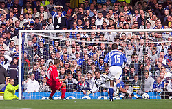 LIVERPOOL, ENGLAND - Saturday, September 15, 2001: Liverpool's Michael Owen scores from the penalty spot against Everton's goalkeeper Paul Gerrard during the Premiership match at Goodison Park. (Pic by David Rawcliffe/Propaganda)