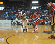"""Ole Miss guard Chris Warren (12) is defended by Georgia's Dustin Ware (3) at the C.M. """"Tad"""" Smith Coliseum in Oxford, Miss. on Saturday, January 15, 2011. Georgia won 98-76.  (AP Photo/Oxford Eagle, Bruce Newman)"""