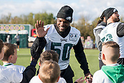 Philadelphia Eagles LaRoy Reynolds LB (50) high fives the kids during the flag event during the press, training and media day for Philadephia Eagles at London Irish Training Ground, Hazelwood Centre, United Kingdom on 26 October 2018. Picture by Jason Brown.