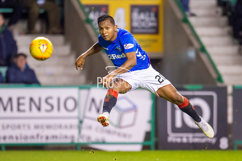 Alfredo Morelos (#20) of Rangers FC takes a shot at goal during the Ladbrokes Scottish Premiership match between Hibernian and Rangers at Easter Road, Edinburgh, Scotland on 19 December 2018.