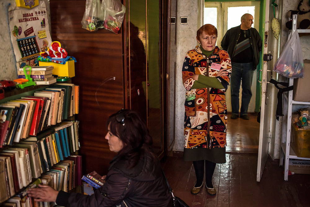 DNIPROPETROVSK, UKRAINE - OCTOBER 10: Donated books and toys are available for people who fled with few belongings at The Aid of Dnipro, a charity organization providing assistance to displaced people from Eastern Ukraine, on October 10, 2014 in Dnipropetrovsk, Ukraine. While the charity has received many donations of clothes and toys, they are having a difficult time providing enough food to those in need. The United Nations has registered more than 360,000 people who have been forced to leave their homes due to fighting in the East, though the true number is believed to be much higher. (Photo by Brendan Hoffman/Getty Images) *** Local Caption ***