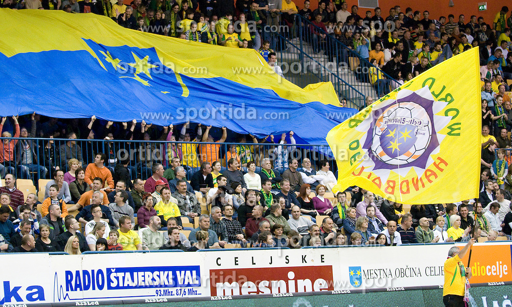Fans with flag of town Celje at handball quarter final EHF Cup match between RK Celje Pivovarna Lasko and SG Handewitt Flensburg, on April 3, 2010, Dvorana Zlatorog, Celje, Slovenia. Flensburg won 32:35. (Photo by Matic Klansek Velej / Sportida)