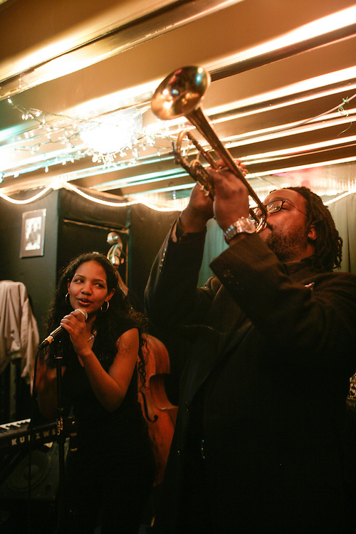 A trumpet player and a singer at a Jazz Club in New York.