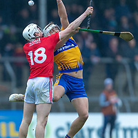 Clare's Aaron Shanagher and Cork's David Griffin both jump for the ball