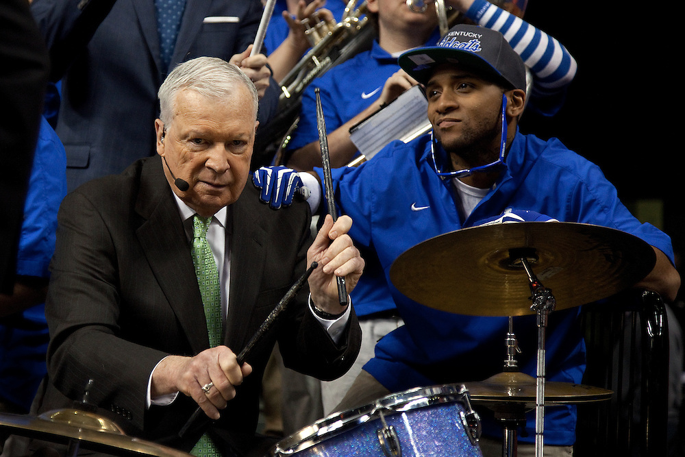 ESPN's Digger Phelps, left, plays the drums with UK band member Harold Burns during an ESPN Gameday broadcast from Rupp Arena before the Missouri vs. Kentucky game, Saturday, Feb. 23, 2013 in Lexington.