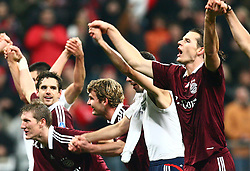 Munich, Germany - Wednesday, March 7, 2007: Bayern Munich's Owen Hargreaves, Bastian Schweinsteiger, Andreas Goerlitz, Roy Makaay and Daniel van Buyten celebrate beating Real Madrid during the UEFA Champions League First Knock-out Round 2nd Leg at the Allianz Arena. (Pic by Christian Kolb/Propaganda/Hochzwei) +++UK SALES ONLY+++