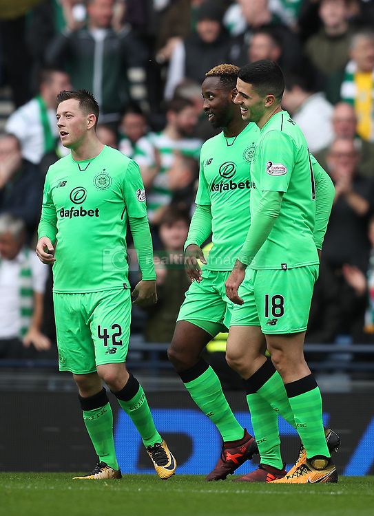 Celtic's Moussa Dembele (centre) celebrates scoring his side's fourth goal of the game with teammates Callum McGregor (left) and Tom Rogic during the Betfred Cup, semi-final match at Hampden Park, Glasgow.