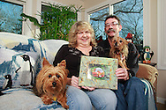 Patty and Jerry Woodbury with one of their photos in a frame they made in an art class, photographed at their home in Kettering, joined by thier dogs Bondi (left) and Sydney, Saturday, December 22, 2012.