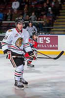 KELOWNA, CANADA - OCTOBER 4:  Derrick Pouliot #51 of the Portland Winterhawks skates on the ice  at the Kelowna Rockets on October 4, 2013 at Prospera Place in Kelowna, British Columbia, Canada (Photo by Marissa Baecker/Shoot the Breeze) *** Local Caption ***