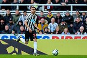 Miguel Almiron (#24) of Newcastle United dribbles the ball down the left wing during the Premier League match between Newcastle United and Everton at St. James's Park, Newcastle, England on 9 March 2019.