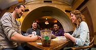 Union employees enjoy a card game in Der Stiftskeller in Memorial Union, 2013.