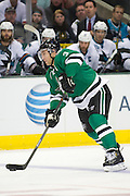 DALLAS, TX - OCTOBER 17:  Stephane Robidas #3 of the Dallas Stars takes a shot on goal against the San Jose Sharks on October 17, 2013 at the American Airlines Center in Dallas, Texas.  (Photo by Cooper Neill/Getty Images) *** Local Caption *** Stephane Robidas