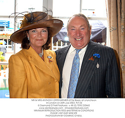 MR & MRS ANTHONY OPPENHEIMER of De Beers, at a luncheon in London on 26th July 2003.PLT 24