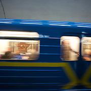 KIEV, UKRAINE - February 25, 2014: A train passes by a soviet era mural in Arsenalia Metro station, Kiev. CREDIT: Paulo Nunes dos Santos