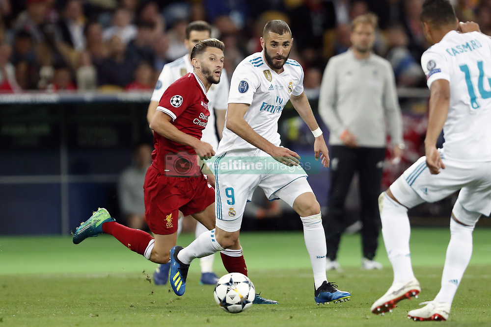 (L-R) Adam Lallana of Liverpool FC, Karim Benzema of Real Madrid during the UEFA Champions League final between Real Madrid and Liverpool on May 26, 2018 at NSC Olimpiyskiy Stadium in Kyiv, Ukraine