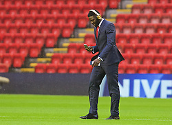 LIVERPOOL, ENGLAND - Sunday, November 8, 2015: Crystal Palace's Bakary Sako makes a FaceTime call on the pitch before the Premier League match against Liverpool at Anfield. (Pic by David Rawcliffe/Propaganda)