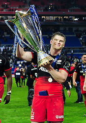 Owen Farrell of Saracens with the European Rugby Champions Cup trophy - Mandatory byline: Patrick Khachfe/JMP - 07966 386802 - 14/05/2016 - RUGBY UNION - Grand Stade de Lyon - Lyon, France - Saracens v Racing 92 - European Rugby Champions Cup Final.