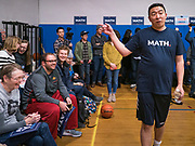 12 DECEMBER 2019 - DES MOINES, IOWA: ANDREW YANG walks through the gym after a basketball game with J.D. Scholten in the gym in the Ames, IA, City Hall. Scholten is an Iowa Democrat running against Republican Congressman Steve King. Yang, an entrepreneur, is running for the Democratic nomination for the US Presidency in 2020. He brought bus tour to Ames, IA, Thursday. Iowa hosts the the first election event of the presidential election cycle. The Iowa Caucuses will be on Feb. 3, 2020.          PHOTO BY JACK KURTZ